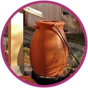photo: terra cotta colored, plastic rain barrel